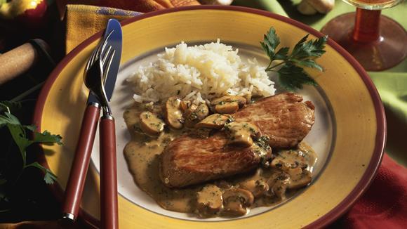 Schweinsschnitzel mit Kräuter-Champignons und Kartoffelpüree