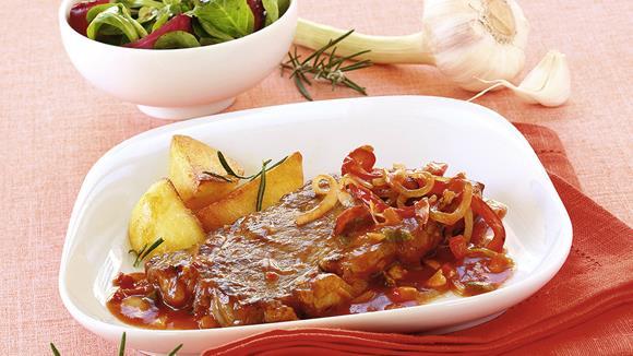 Schweinskoteletts auf Ungarische Art mit Maiskölbchen und Schinken Rezept