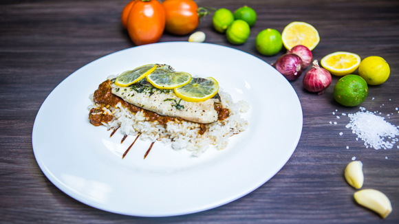 Foil Baked Tilapia in Swahili Spiced Passion-Tomato Sauce