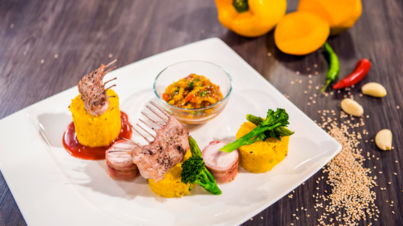 Pistachio Crusted Rabbit with Herb Polenta, Raw Mango Salsa and Cranberry