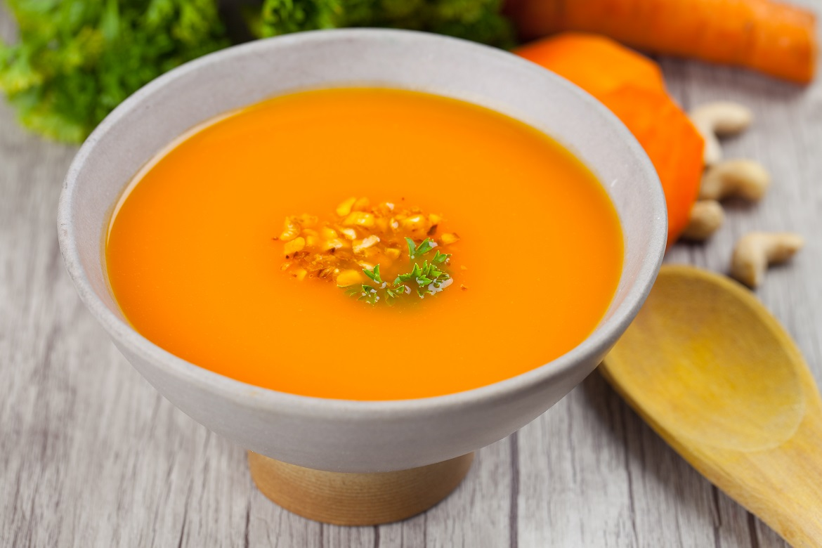 Creamy carrot soup with roasted nuts