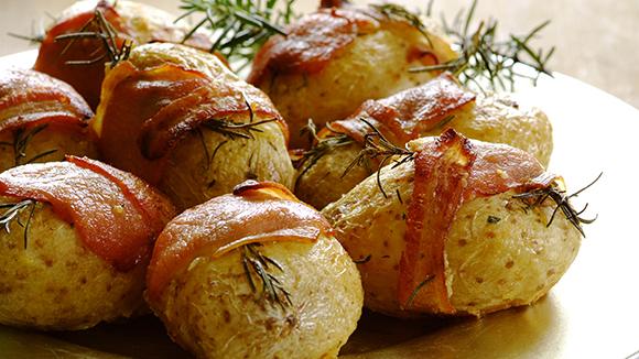 Bacon and rosemary wrapped roast potatoes