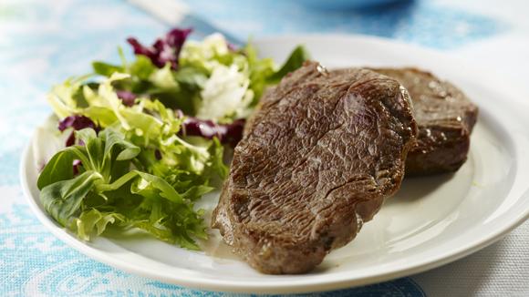 Steak aux oignons caramélisés