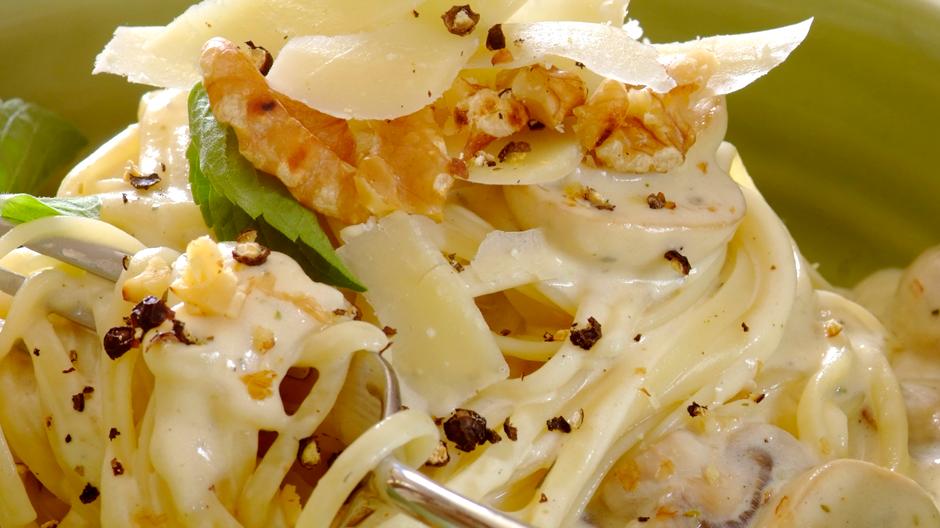 Receita Linguini com cogumelos e molho de queijo
