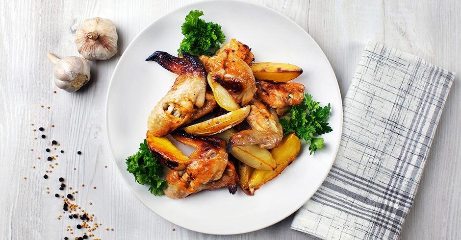 Куриные крылышки с картофелем в маринаде из апельсина и меда