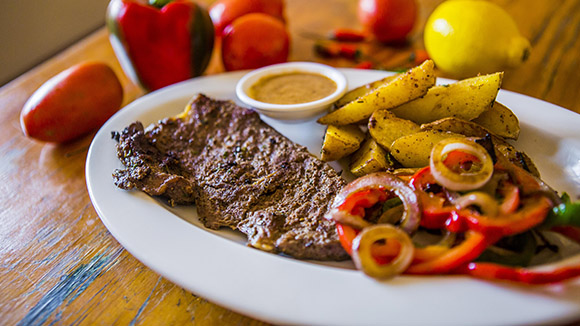Pan Fried Pepper Steak Served with Potato Wedges